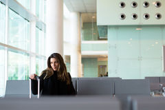 Pensive woman waiting for flight at the airport in winter Stock Photos