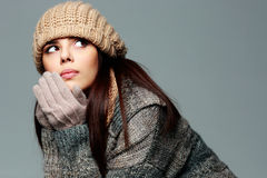 Pensive woman in warm winter outfit looking away Royalty Free Stock Images
