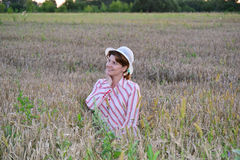 Pensive woman on a wheat field Stock Photos