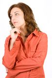 Pensive woman on white. Portrait of a pensive woman on white background Royalty Free Stock Image