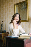 Pensive woman working at home Royalty Free Stock Image