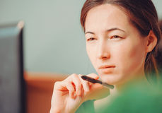 Pensive woman working over the laptop Stock Photography