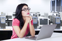Pensive worker sitting in the office room Stock Photography
