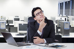 Pensive worker thinking a solution Stock Images