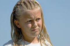 Pensive Worried Girl. Pensive Worried Blond Girl with Braids Stock Photos