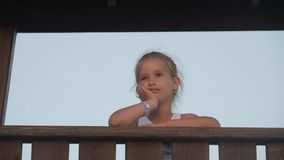Pensive worried girl hoping. Close up portrait of teen girl watching sunset or sunrise over sea. stock video footage