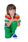 Pensive young boy in the green pants Royalty Free Stock Image