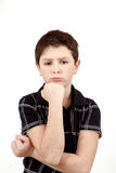 Pensive young boy isolated on white background Stock Images