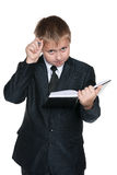 Pensive young boy with a notebook Royalty Free Stock Photos