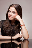 Pensive young brunette. Royalty Free Stock Photography