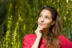 Pensive young brunette woman. Stock Photo