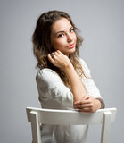 Pensive young brunette woman. Royalty Free Stock Image
