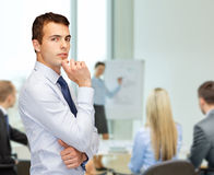 Pensive young buisnessman at office Royalty Free Stock Image