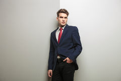 Pensive young business man holding one hand in his pocket Stock Image