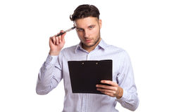 Pensive Young Businessman Holding A Tablet And Pen Royalty Free Stock Photo
