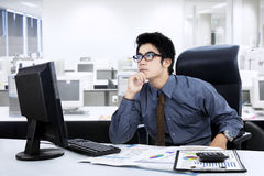 Pensive young businessman Stock Image