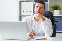 Pensive young businessman with notebook Stock Photo