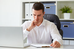 Pensive young businessman with notebook Royalty Free Stock Image