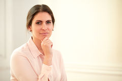 Pensive young businesswoman looking at you Royalty Free Stock Image