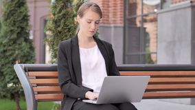Pensive Young Businesswoman working on Laptop, Sitting Outdoor on Bench. 4k high quality, 4k high quality stock video