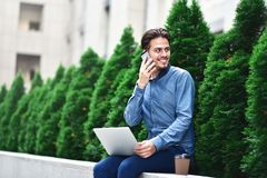 Pensive young caucasian man using laptop to chat online stock photos