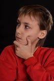 Pensive young fellow Stock Photos