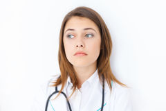 Pensive young female doctor Royalty Free Stock Photos