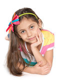 Pensive young girl against the white Royalty Free Stock Image
