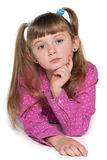 Pensive young girl against the white Royalty Free Stock Images