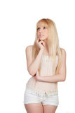 Pensive young girl with blond hair Stock Images