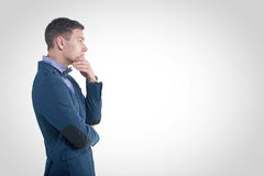 Pensive young handsome man in classical costume Stock Photography