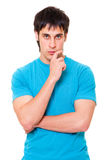 Pensive young man. Portrait of pensive young man in blue t-shirt. isolated on white background Stock Photo