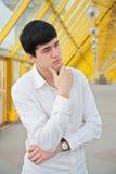 Pensive young man stock photos