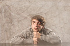 Pensive young man in gray pullover Royalty Free Stock Photos