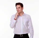 Pensive young man with interested gesture Royalty Free Stock Photo