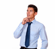 Pensive young man looking to his right Stock Image