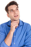Pensive young man looking up Royalty Free Stock Photos