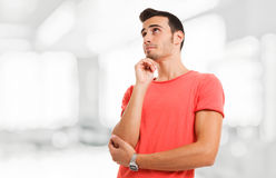 Pensive young man Stock Photo