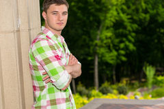 Pensive young man standing near wall in a forest Stock Images