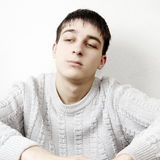 Pensive Young Man. Toned Photo of Pensive Young Man Portrait at the Home stock images