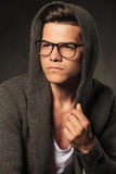 Pensive young man wearing a grey hoodie. Stock Image