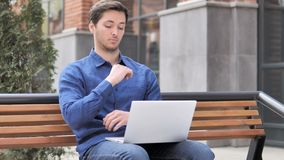 Pensive Young Man working on Laptop, Sitting Outdoor on Bench. 4k high quality, 4k high quality stock video
