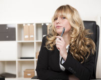 Pensive young manageress in the office Royalty Free Stock Photo