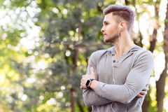 Pensive young sportsman resting after training Stock Image