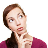 Pensive young woman. Thinking with hand on her chin Stock Photo