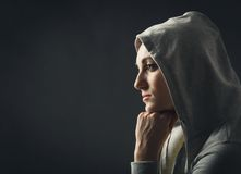 Pensive young woman Stock Image