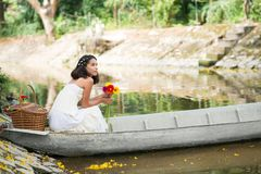 Pensive young woman in the boat Stock Photo