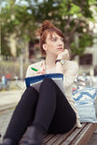 Pensive young woman getting inspired by urban life Royalty Free Stock Photos