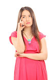 Pensive young woman Stock Photo