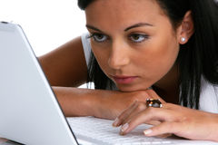 Pensive young woman with a laptop computer Stock Images
